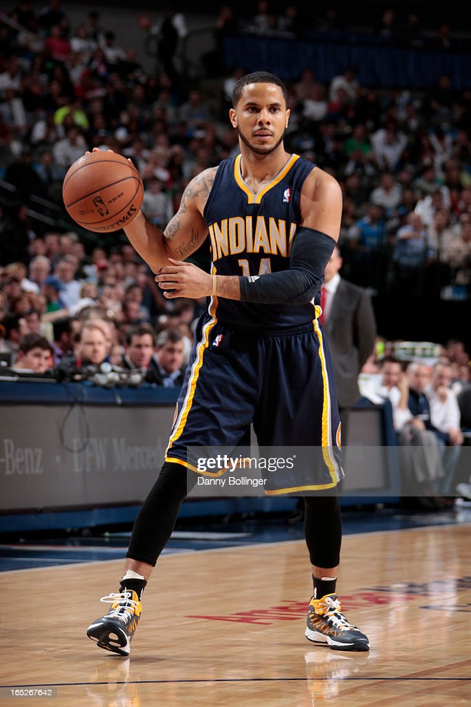 D.J. Augustin #14 of the Indiana Pacers looks to pass the ball against the Dallas Mavericks on March 28, 2013 at the American Airlines Center in Dallas, Texas.
