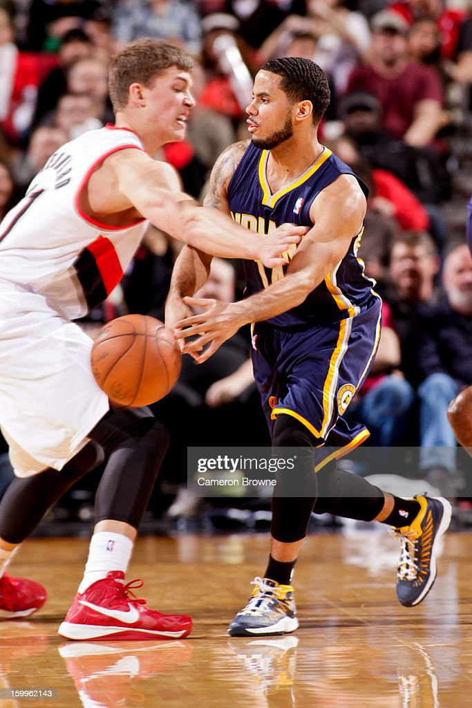 D.J. Augustin #14 of the Indiana Pacers passes the ball against Meyers Leonard #11 of the Portland Trail Blazers on January 23, 2013 at the Rose Garden Arena in Portland, Oregon.