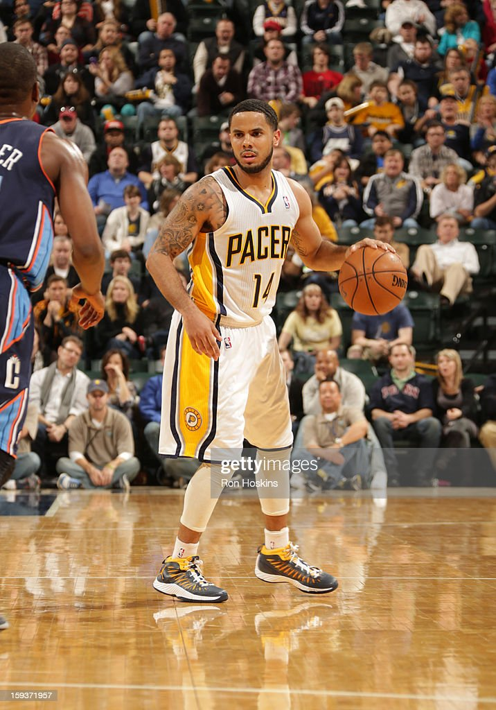 D.J. Augustin #14 of the Indiana Pacers protects the ball during the game between the Indiana Pacers and the Charlotte Bobcats on January 12, 2013 at Bankers Life Fieldhouse in Indianapolis, Indiana.