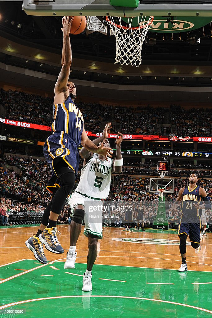 D.J. Augustin #14 of the Indiana Pacers shoots a layup against Kevin Garnett #5 of the Boston Celtics on January 4, 2013 at the TD Garden in Boston, Massachusetts.
