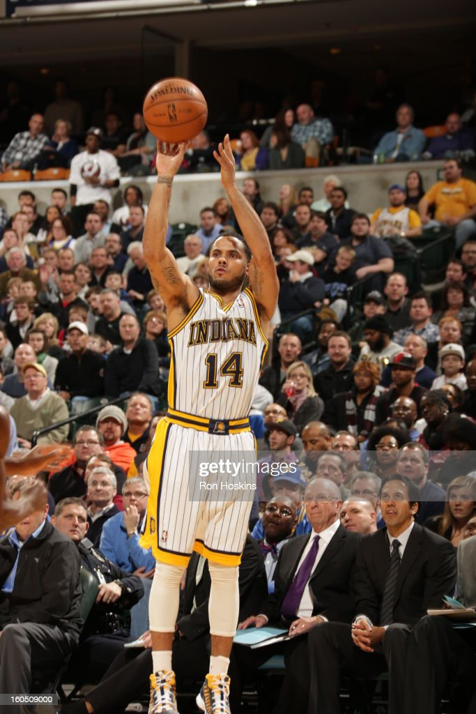 D.J. Augustin #14 of the Indiana Pacers shoots a three point shot against the Miami Heat on February 1, 2013 at Bankers Life Fieldhouse in Indianapolis, Indiana.