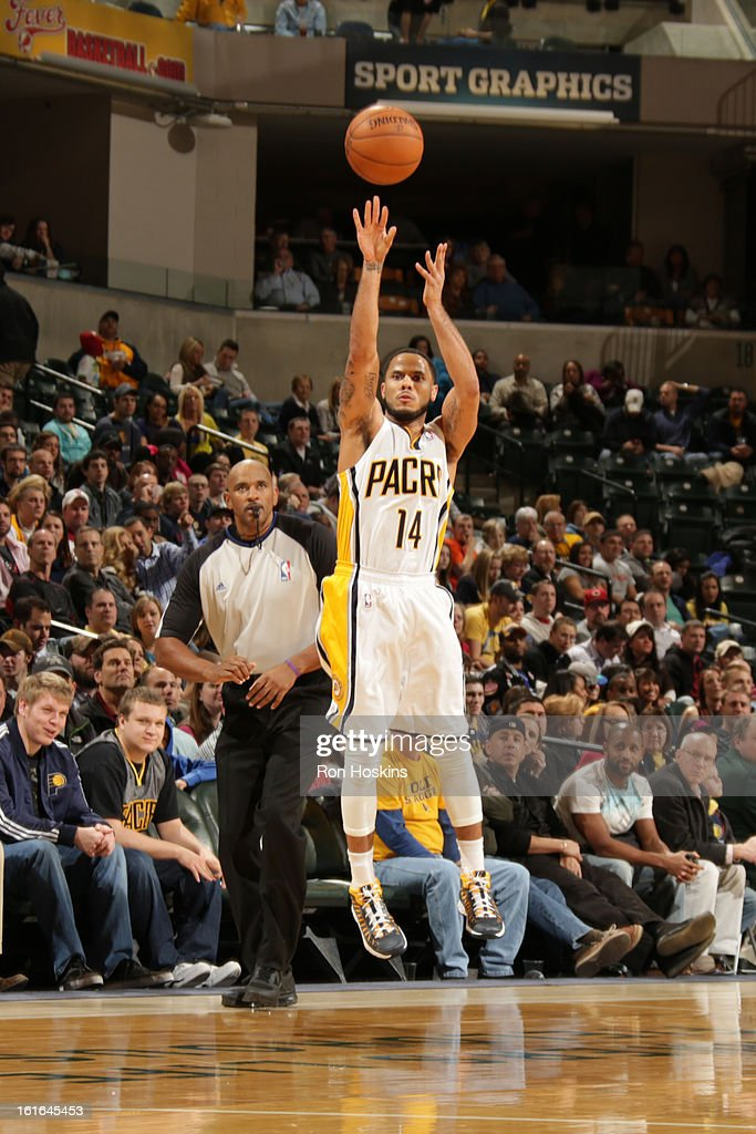 D.J. Augustin #14 of the Indiana Pacers shoots a three pointer against the Charlotte Bobcats on February 13, 2013 at Bankers Life Fieldhouse in Indianapolis, Indiana.