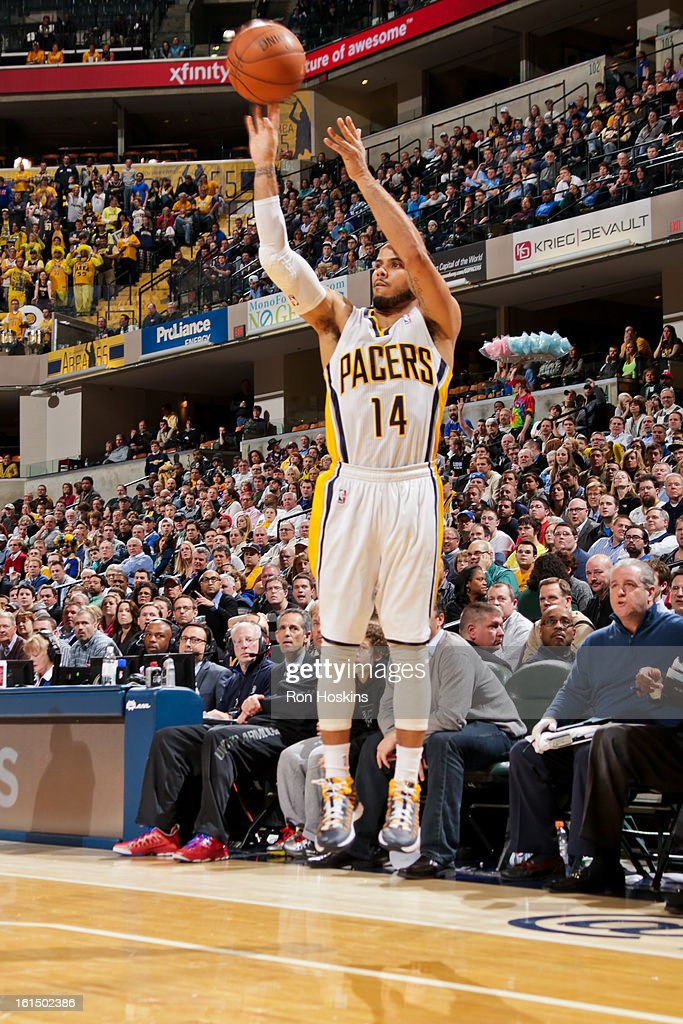 D.J. Augustin #14 of the Indiana Pacers shoots a three-pointer against the Brooklyn Nets on February 11, 2013 at Bankers Life Fieldhouse in Indianapolis, Indiana.
