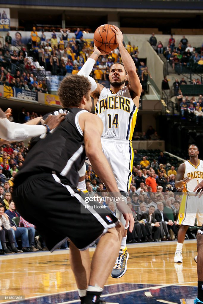D.J. Augustin #14 of the Indiana Pacers shoots in the lane against the Brooklyn Nets on February 11, 2013 at Bankers Life Fieldhouse in Indianapolis, Indiana.