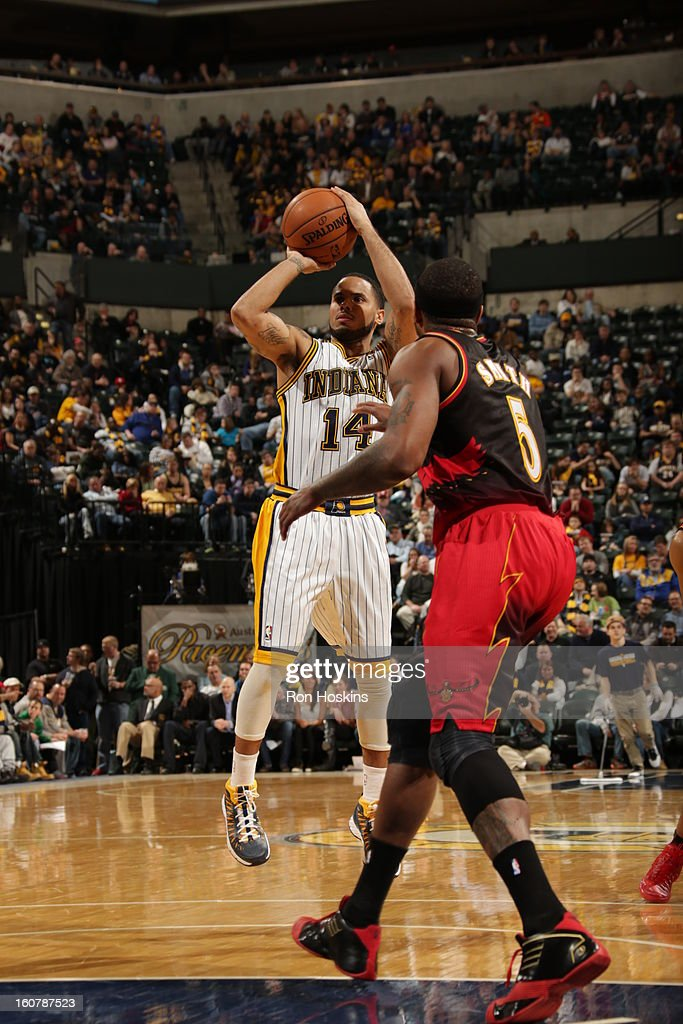 D.J. Augustin #14 of the Indiana Pacers takes a shot in traffic against the Atlanta Hawks on February 5, 2013 at Bankers Life Fieldhouse in Indianapolis, Indiana.