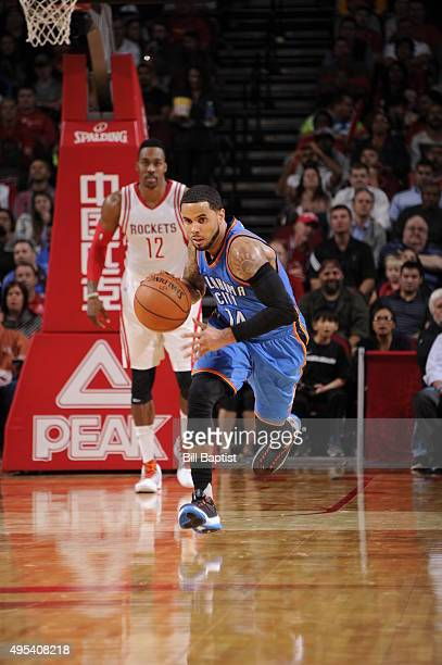 J Augustin of the Oklahoma City Thunder brings the ball up court against the Houston Rockets on November 2 2015 at the Toyota Center in Houston Texas...