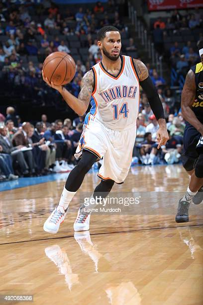 J Augustin of the Oklahoma City Thunder drives to the basket against Fenerbahce during a preseason game on October 9 2015 at Chesapeake Energy Arena...