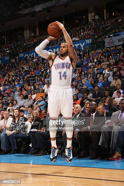 J Augustin of the Oklahoma City Thunder shoots against the Sacramento Kings on April 10 2015 at the Chesapeake Energy Arena in Oklahoma City Oklahoma...