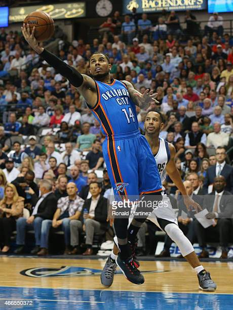 J Augustin of the Oklahoma City Thunder takes a shot against the Dallas Mavericks at American Airlines Center on March 16 2015 in Dallas Texas NOTE...