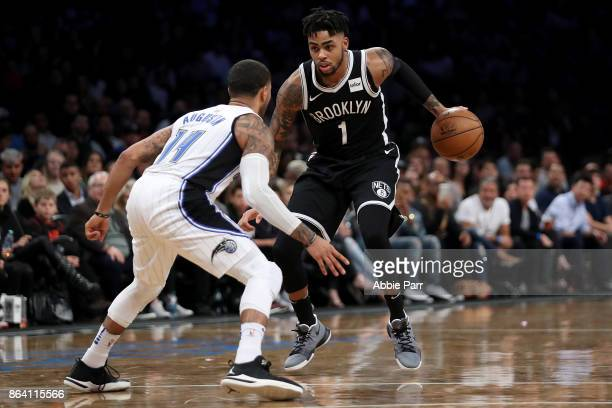 J Augustin of the Orlando Magic defends against D'Angelo Russell of the Brooklyn Nets in the second half during their game at Barclays Center on...