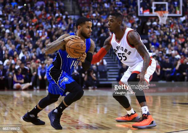 J Augustin of the Orlando Magic dribbles the ball as Delon Wright of the Toronto Raptors defends during the first half of an NBA game at Air Canada...