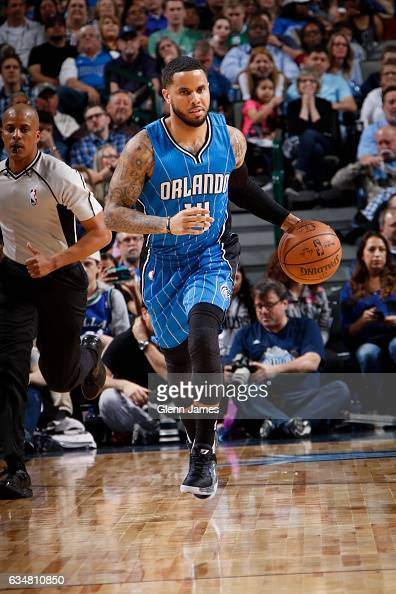 J Augustin of the Orlando Magic handles the ball against the Dallas Mavericks on February 11 2017 at the American Airlines Center in Dallas Texas...