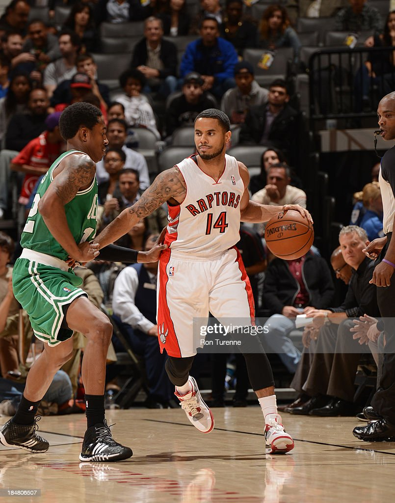 <a gi-track='captionPersonalityLinkClicked' href=/galleries/search?phrase=D.J.+Augustin&family=editorial&specificpeople=3847521 ng-click='$event.stopPropagation()'>D.J. Augustin</a> #14 of the Toronto Raptors handles the ball against <a gi-track='captionPersonalityLinkClicked' href=/galleries/search?phrase=MarShon+Brooks&family=editorial&specificpeople=4884862 ng-click='$event.stopPropagation()'>MarShon Brooks</a> #12 of the Boston Celtics during the game on October 16, 2013 at the Air Canada Centre in Toronto, Ontario, Canada.