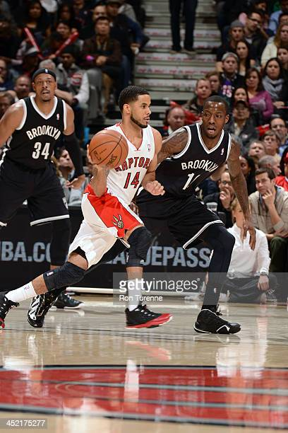 J Augustin of the Toronto Raptors handles the ball against Tyshawn Taylor of the Brooklyn Nets on November 26 2013 at the Air Canada Centre in...