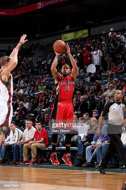Augustin of the Toronto Raptors shoots against the Milwaukee Bucks on October 25 2013 at the BMO Harris Bradley Center in Milwaukee Wisconsin NOTE TO...