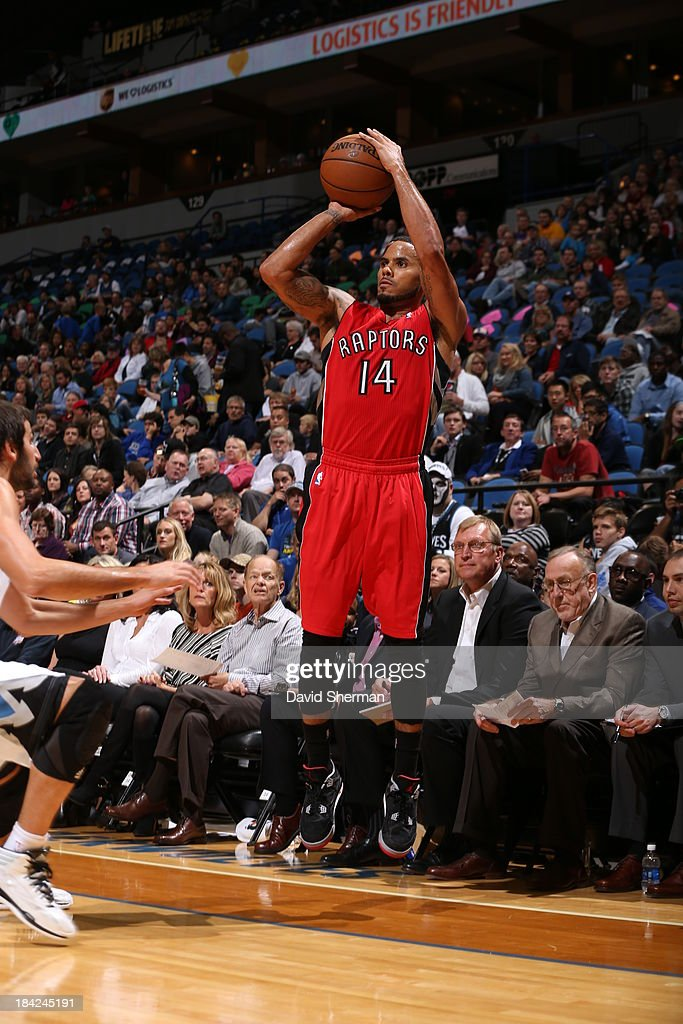 J Augustin of the Toronto Raptors shoots against the Minnesota Timberwolves during the preseason game on October 12 2013 at Target Center in...