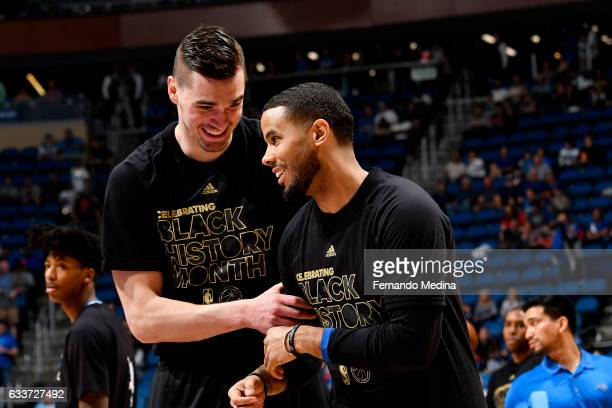 J Augustin talks with Mario Hezonja of the Orlando Magic before the game against the Toronto Raptors on February 3 2017 at Amway Center in Orlando...