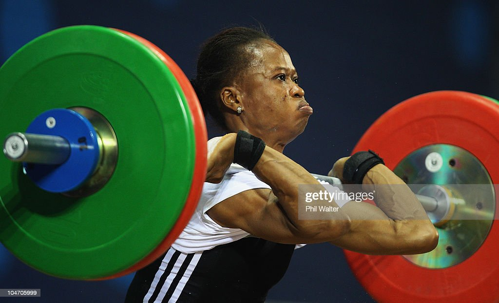 Augustina Nkem Nwaokolo of Nigeria competes in the Womens 48 kg weightlifting final during day one of the Delhi 2010 Commonwealth Games at Jawaharlal Nehru Sports Complex on October 4, 2010 in Delhi, India.
