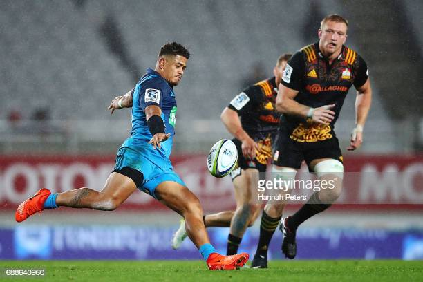Augustine Pulu of the Blues kicks the ball through during the round 14 Super Rugby match between the Blues and the Chiefs and Eden Park on May 26...