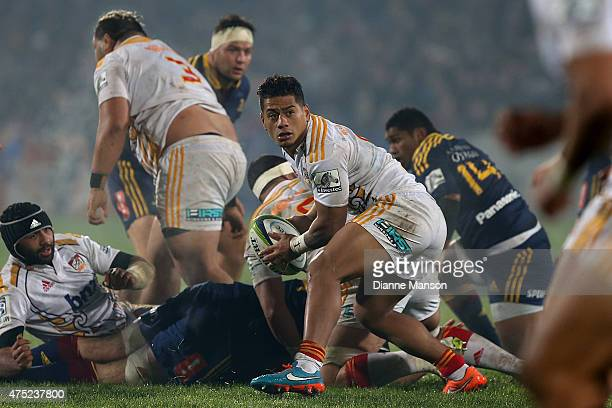 Augustine Pulu of the Chiefs gets the ball away during the round 16 Super Rugby match between the Highlanders and the Chiefs at Rugby Park Stadium on...