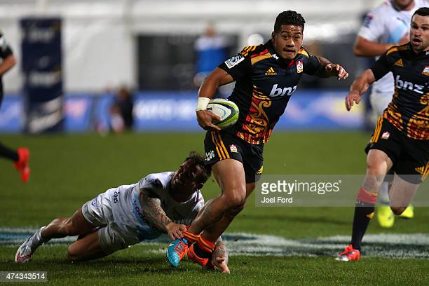 Augustine Pulu of the Chiefs runs with the ball during the round 15 Super Rugby match between the Chiefs and the Bulls at Rotorua International...