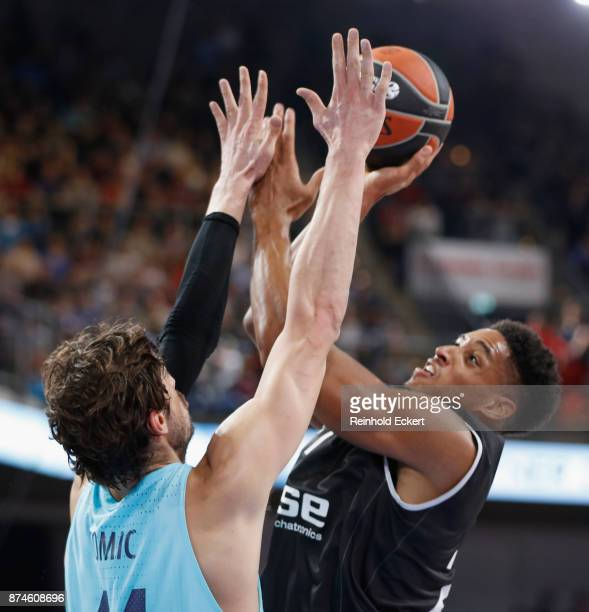 Augustine Rubit #21 of Brose Bamberg competes with Ante Tomic #44 of FC Barcelona Lassa in action during the 2017/2018 Turkish Airlines EuroLeague...