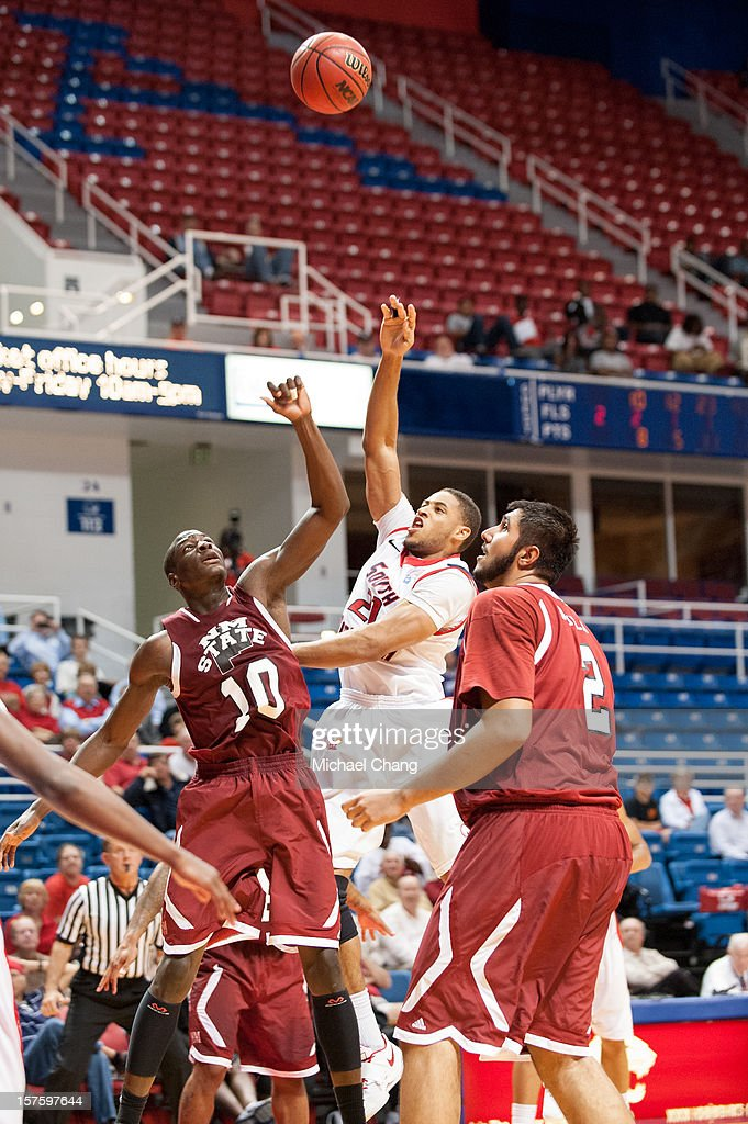 Augustine Rubit #21 of the South Alabama Jaguars takes a shot over Bandja Sy #10 of the New Mexico State Aggies at USA Mitchell Center on December 4, 2012 in Mobile, Alabama. At halftime New Mexico State leads South Alabama 31-25.