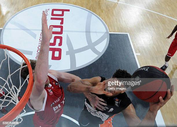 BAMBERG GERMANY Augustine Rubit shoots agains Nicolo Melli during the BEKO BBL Final game 1 between Brose Baskets Bamberg and ratipopharm Ulm at...