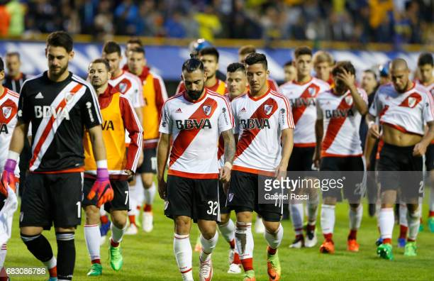 Augusto Batalla goalkeeper of River Plate and teammates Ariel Rojas and Sebastian Driussi leave the field at the end of the first half during a match...