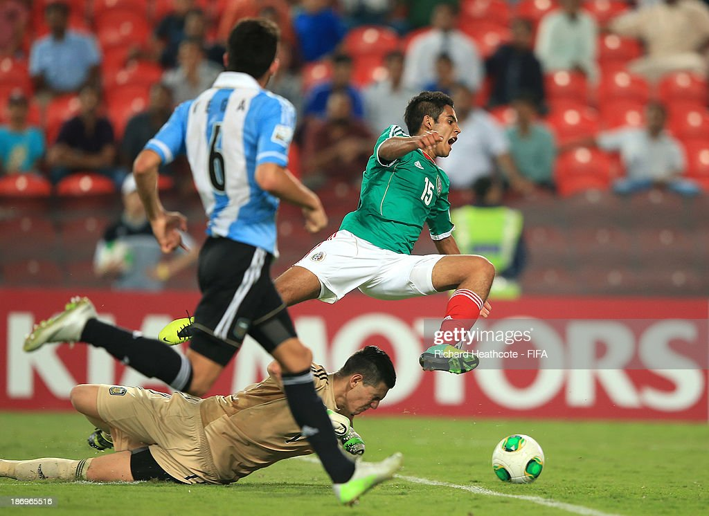 Augusto Batalla of Argentina braings down Christian Tovar of Mexico and is sent off during the FIFA U-17 World Cup UAE 2013 Semi Final match between Argentina and Mexico at the Mohamed Bin Zayed Stadium on November 5, 2013 in Abu Dhabi, United Arab Emirates.