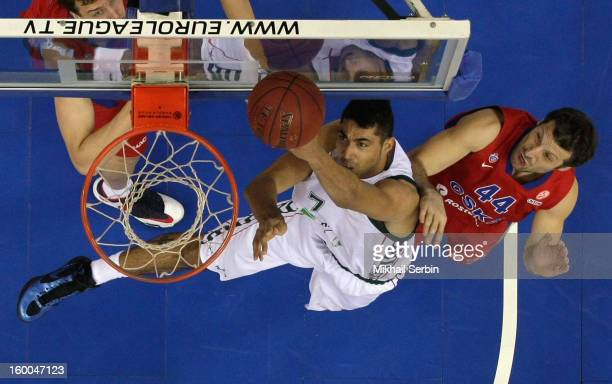 Augusto Cesar Lima #7 of Unicaja Malaga competes with Teodoros Papaloukas #44 of CSKA Moscow during the 20122013 Turkish Airlines Euroleague Top 16...