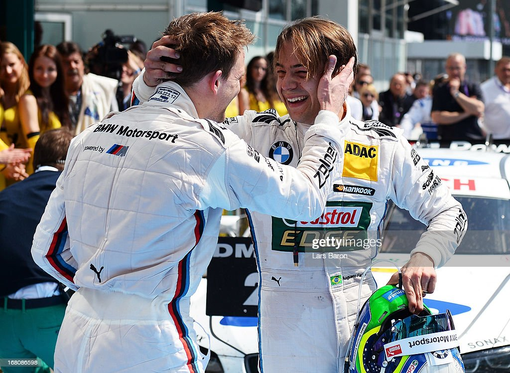 Augusto Farfus of Brazil and BMW Team RBM celebrates with team mate Dirk Werner of Germany and BMW Team Schnitzer after winning the first round of the DTM 2013 German Touring Car Championship at Hockenheimring on May 5, 2013 in Hockenheim, Germany.