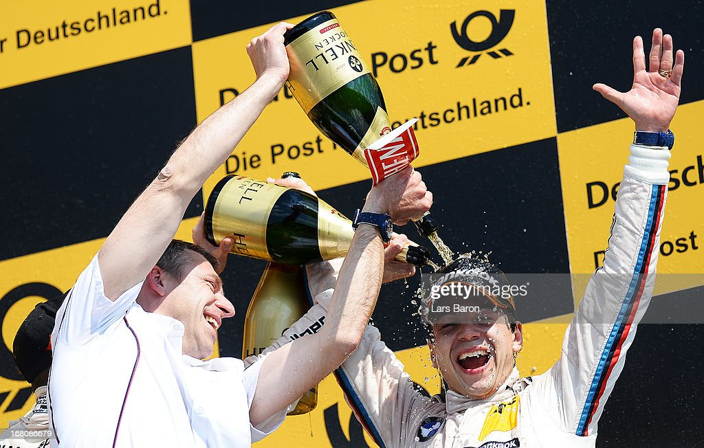 Augusto Farfus of Brazil and BMW Team RBM celebrates with team mates after winning the first round of the DTM 2013 German Touring Car Championship at Hockenheimring on May 5, 2013 in Hockenheim, Germany.