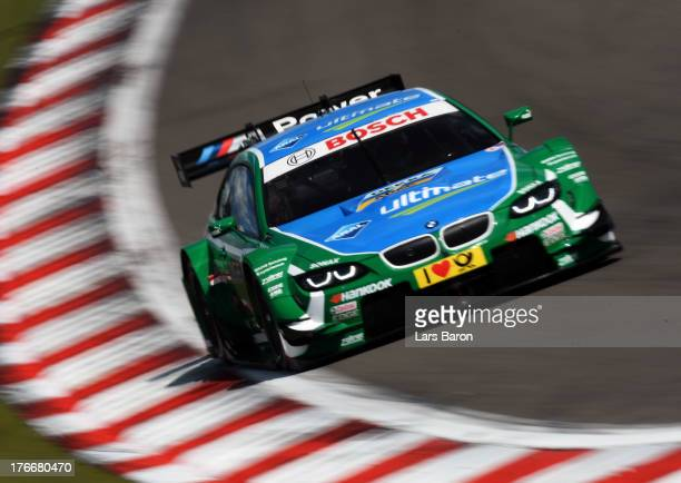 Augusto Farfus of Brazil and BMW Team RBM drives during the qualifying for the seventh round of the DTM 2013 German Touring Car Championship at...