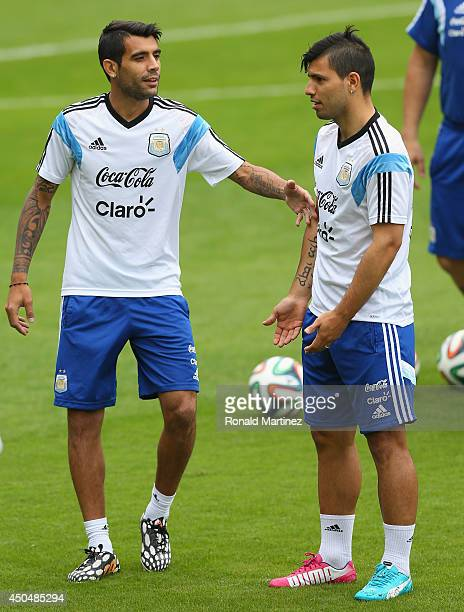 Augusto Fernandez and Sergio Aguero of Argentina during a training session on June 12 2014 in Vespasiano Brazil