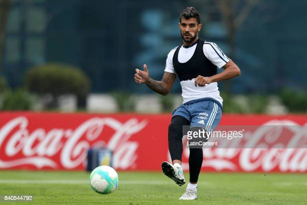Augusto Fernandez kicks the ball during a training session at 'Julio Humberto Grondona' training camp on August 29 2017 in Ezeiza Argentina
