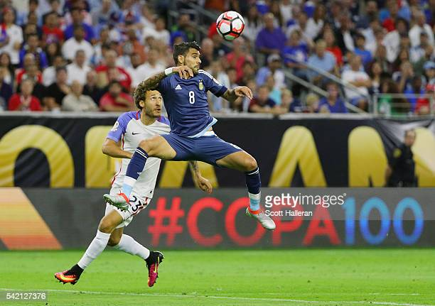 Augusto Fernandez of Argentina and Fabian Johnson of the United States battle for the ball in the first half during a 2016 Copa America Centenario...
