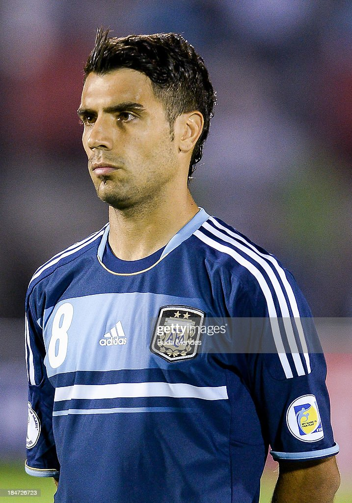 <a gi-track='captionPersonalityLinkClicked' href=/galleries/search?phrase=Augusto+Fernandez&family=editorial&specificpeople=684736 ng-click='$event.stopPropagation()'>Augusto Fernandez</a> of Argentina looks on during a match between Uruguay and Argentina as part of the 18th round of the South American Qualifiers for the FIFA World Cup Brazil 2014 at Centenario Stadium Stadium on October 15, 2013 in Montevideo, Uruguay.
