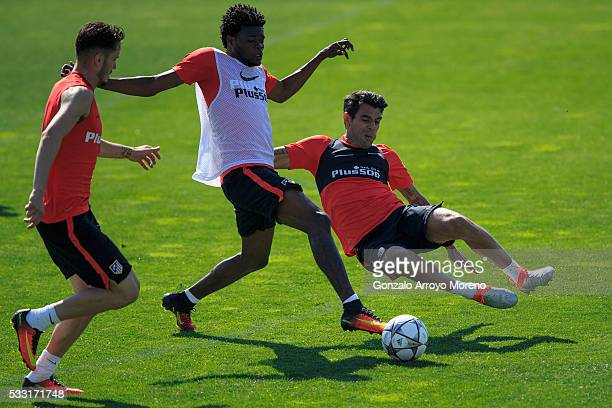 Augusto Fernandez of Atletico de Madrid competes for the ball with with teammate Thomas Teye Partey during the training session during the Club...