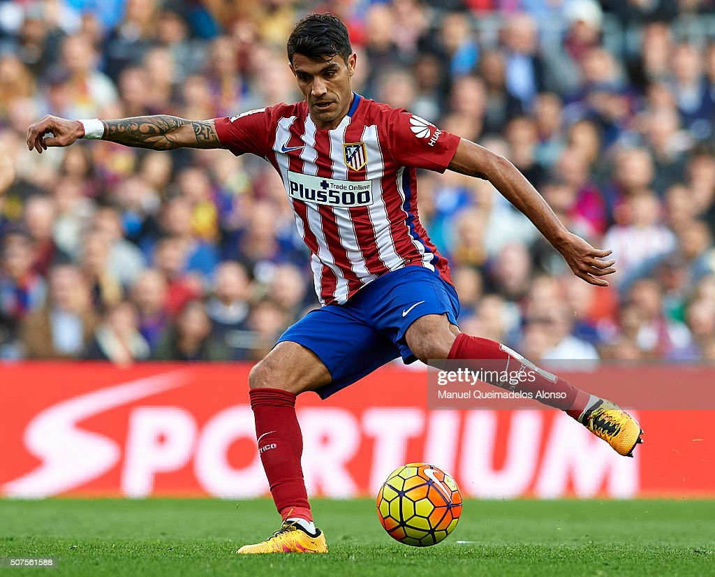 <a gi-track='captionPersonalityLinkClicked' href=/galleries/search?phrase=Augusto+Fernandez&family=editorial&specificpeople=684736 ng-click='$event.stopPropagation()'>Augusto Fernandez</a> of Atletico de Madrid in action during the La Liga match between FC Barcelona and Atletico de Madrid at Camp Nou on January 30, 2016 in Barcelona, Spain.