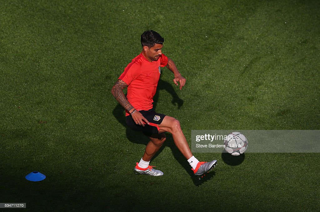 <a gi-track='captionPersonalityLinkClicked' href=/galleries/search?phrase=Augusto+Fernandez&family=editorial&specificpeople=684736 ng-click='$event.stopPropagation()'>Augusto Fernandez</a> of Atletico Madrid controls the ball during an Atletico de Madrid training session on the eve of the UEFA Champions League Final against Real Madrid at Stadio Giuseppe Meazza on on May 27, 2016 in Milan, Italy.
