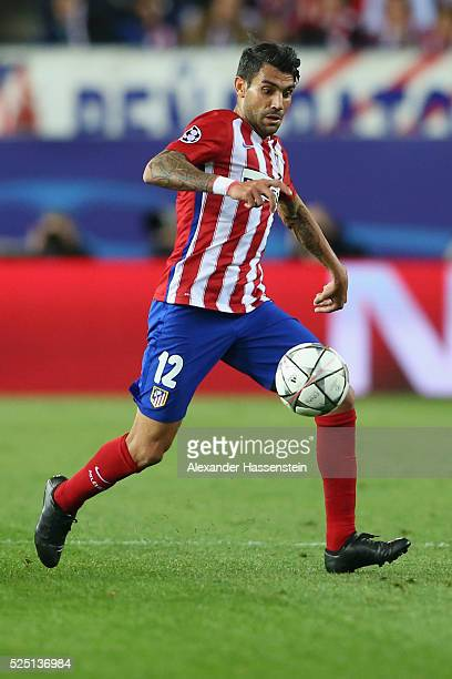 Augusto Fernandez of Atltetico runs with the ball during the UEFA Champions League semi final first leg match between Club Atletico de Madrid and FC...