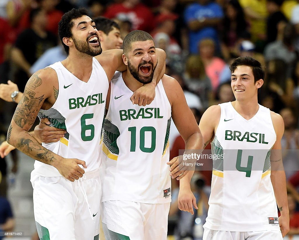 Augusto Lima #6, Carlos Nascimento #10 and Ricardo Fischer #4 of Brazil celebrate an 86-71 win over Canada to win the gold medal in men's basketball during the 2015 Pan Am Games at the Ryerson Athletic Centre on July 25, 2015 in Toronto, Canada.