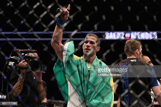 Augusto Mendes celebrates his victory over Frankie Saenz during the UFC Fight Night event at the at Talking Stick Resort Arena on January 15 2017 in...