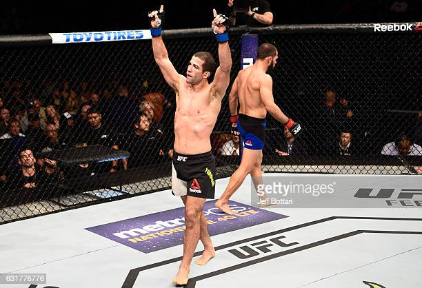 Augusto Mendes of Brazil and Frankie Saenz raise their hands after their bantamweight bout during the UFC Fight Night event inside Talking Stick...