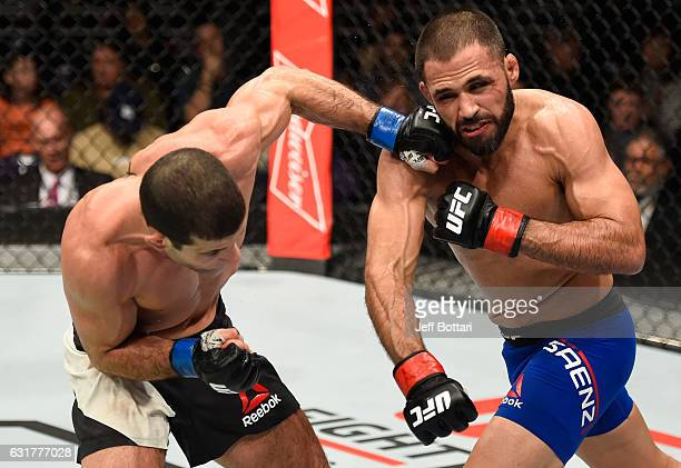Augusto Mendes of Brazil punches Frankie Saenz in their bantamweight bout during the UFC Fight Night event inside Talking Stick Resort Arena on...