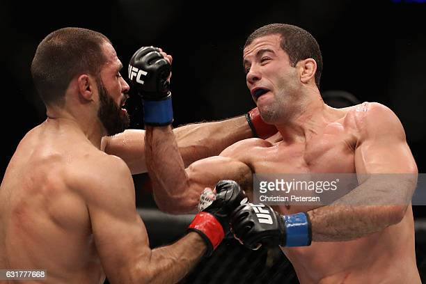Augusto Mendes throws a right on Frankie Saenz during the UFC Fight Night event at the at Talking Stick Resort Arena on January 15 2017 in Phoenix...