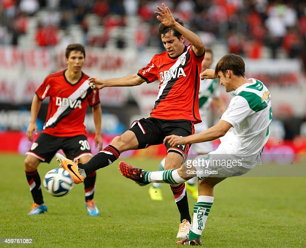 Augusto Solari of River Plate fights for the ball with Nicolas Tagliafico of Banfield during a match between Banfield and River Plate as part of...