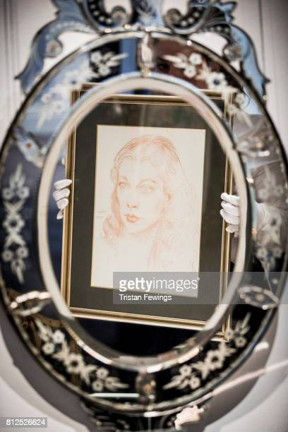 Augustus John's A Portrait of Vivien is reflected in a Venetian style mirror owned by Hollywood Icon and Gone With The Wind Star Vivien Leigh which...