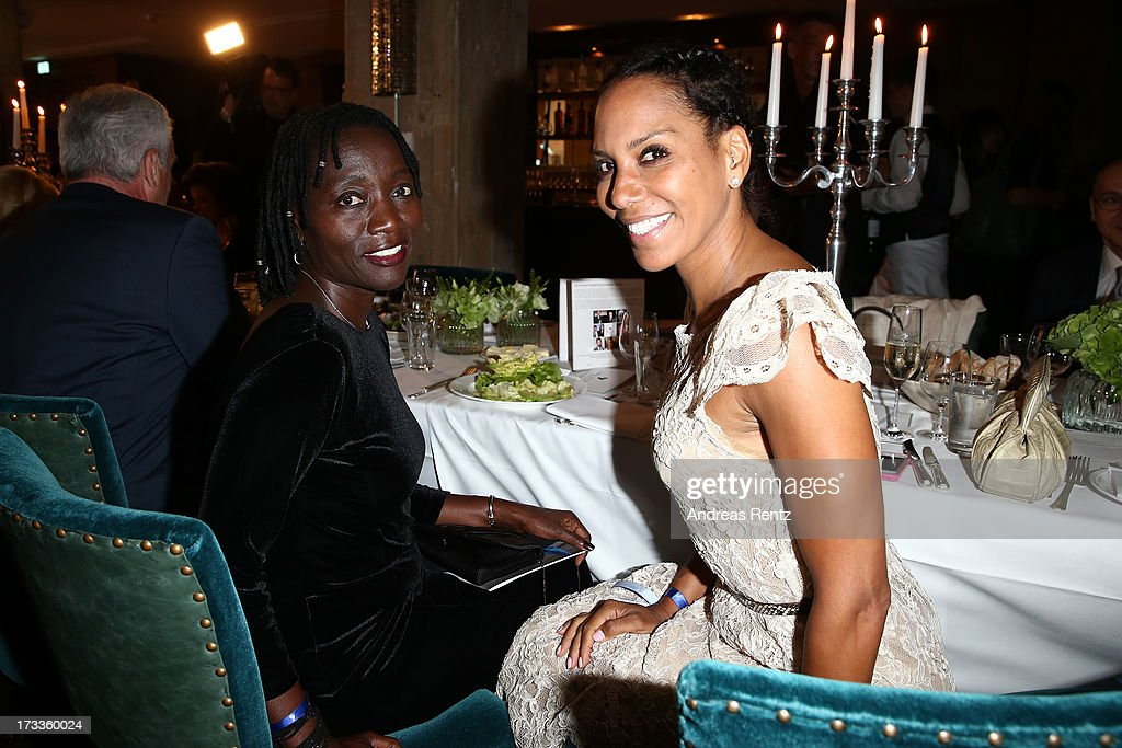 Auma Obama and <a gi-track='captionPersonalityLinkClicked' href=/galleries/search?phrase=Barbara+Becker&family=editorial&specificpeople=544060 ng-click='$event.stopPropagation()'>Barbara Becker</a> attend the Cinema for Peace UN women charity dinner at Soho House on July 12, 2013 in Berlin, Germany.